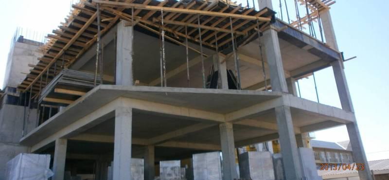 Двухэтажный монолитный коттедж