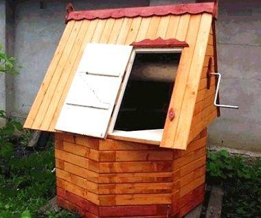 Круглый колодец с крышей в виде дома