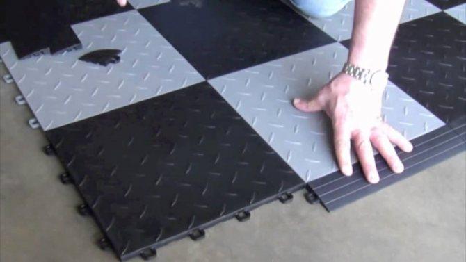 Укладка полимерной плитки на пол гаража